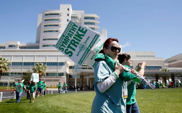 Shannon Hartman, a medical assistant for the University of California,Davis Medical system in Carmichael, joined hundreds of other UC medical workers picketing the UC Davis Medical Center in Sacramento, Calif., Tuesday, May 21, 2013. The union representing more than13,000 workers of the Davis Medical Center and four other University of California hospitals began the two-day statewide strike to protest what they say is inadequate staffing and misplaced financial priorities. Photo: Rich Pedroncelli