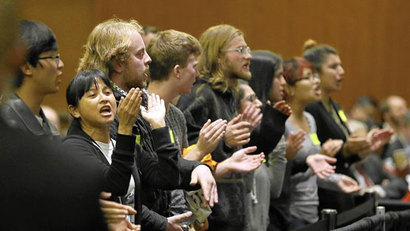 Students shout their disapproval after the UC regents approved a plan to increase tuition. (Eric Risberg / Associated Press)