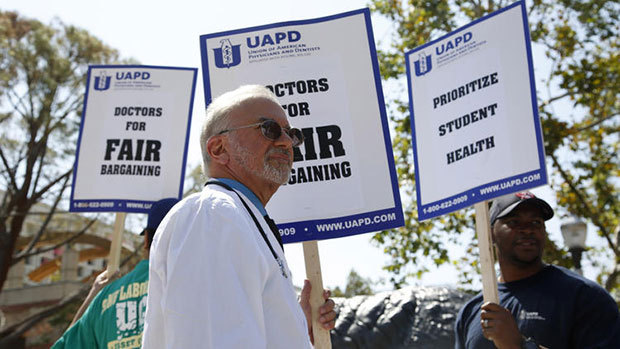 Dr. Stuart Bussey pickets outside the student health center at UCLA on April 11. (Katie Falkenberg / Los Angeles Times)