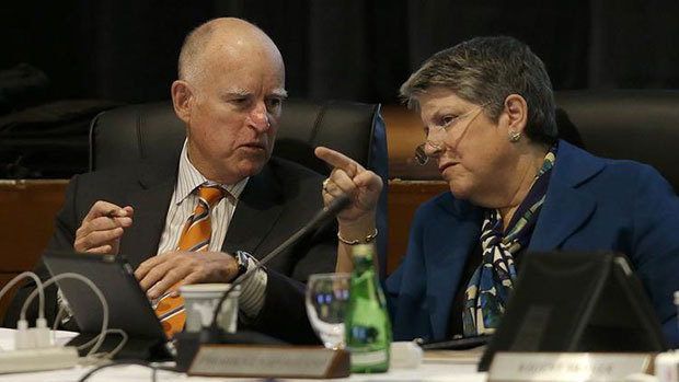 Gov. Jerry Brown talks with University of California president Janet Napolitano during a UC Board of Regents meeting in San Francisco on March 18. (Jeff Chiu / Associated Press)