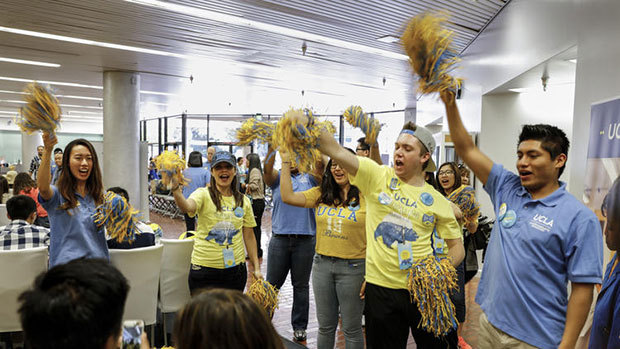 Students and staff cheer on a student who has officially committed to UCLA. The University of California is set to enroll the most diverse class of freshman and transfer students ever. (Jay L. Clendenin / Los Angeles Times)